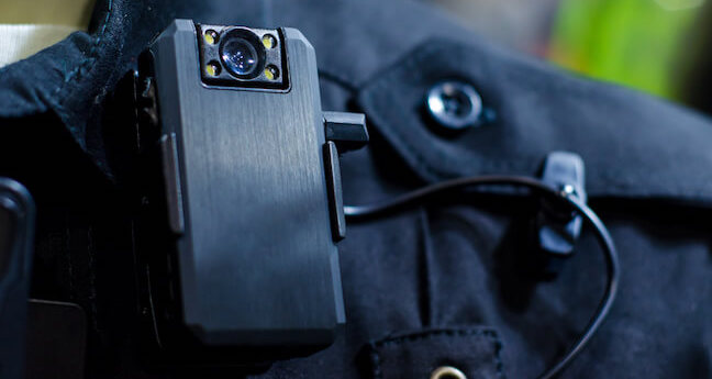 Why do police officers wear body cameras?