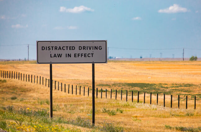Distracted driving laws enforced sign.