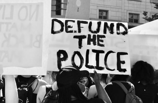 Defund the Police Sign at Protest