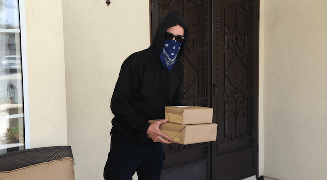 porch pirate stealing packages